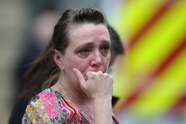 MANCHESTER, ENGLAND - MAY 23:  A woman looks upset after police avacuated the Arndale Centre on May 23, 2017 in Manchester, England.  An explosion occurred at Manchester Arena as concert goers were leaving the venue after Ariana Grande had performed.  Greater Manchester Police are treating the explosion as a terrorist attack and have confirmed 22 fatalities and 59 injured.  (Photo by Christopher Furlong/Getty Images)