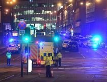 Emergency response vehicles are parked at the scene of a suspected terrorist attack during a pop concert by US star Ariana Grande in Manchester, northwest England on May 23, 2017. / AFP PHOTO / Paul ELLISPAUL ELLIS/AFP/Getty Images  BRITAIN-MUSIC-ATTACK