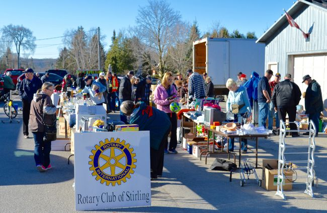 Intelligencer file photo Early morning bargain hunters at last spring's Giant Yard Sale – an annual fundraiser for the Rotary Club of Stirling. This year's sale, originally scheduled for May 6, was postponed due to extremely wet weather and will now be held Saturday, May 27 at the Stirling railway station.