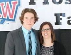 Sault Ste. Marie's Camaryn Baber and his mom, Melissa Holder, took their turn on the introduction stage as the Saginaw Spirit of the Ontario Hockey League held a family banquet as part of its recent prospect camp.