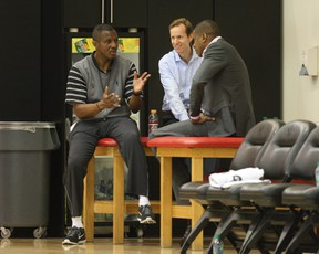 At Toronto Raptors training camp in the Air Canada Centre Raptors brain trust assembles, left to right, as head coach Dwane Casey, assistant GM Jeff Weltman, and GM Masai Ujiri, in downtown Toronto on Dec. 9, 2009. (Stan Behal/Toronto Sun)