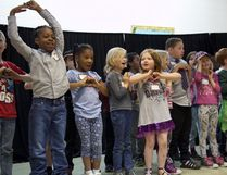 MADELEINE CUMMINGS, Edmonton Examiner Students at R.J. Scott School sing on stage during a farewell event last Thursday. The 58-year-old school is closing this year to make way for the new Ivor Dent replacement school.