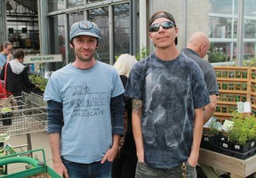 Return the Landscape's Shawn McKnight and Maajiigin Gumig species-at-risk tech Dennis Plain display a collection of native plant species taken from Aamjiwnaang First Nation, at a sale at DeGroots Nurseries on May 13.