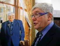 """LARRY WONG, Postmedia Network Former premier Dave Hancock views his official portrait after it was hung at the legislature (alongside other portraits of former premiers) in February. Hancock once said, """"as a politician I am in the business of hope."""""""
