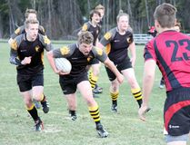 Banff Bears' Isaac Fish heads towards the Rundle College defensive line supported by his teammates during a high school senior boys' rugby game at the Banff Recreation Grounds on Thursday. BCHS defeated its Calgary rivals 23-0. (Russ Ullyot/ Bow Valley Crag & Canyon/ Postmedia Network)