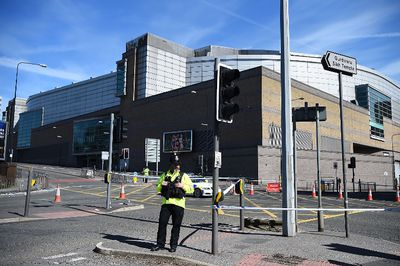 A Police officer stands guard near the Manchester Arena on May 23, 2017 in Manchester, England.  At least 22 people were killed in a suicide bombing at an Ariana Grande concert at Manchester Arena which was packed with children. It is the worst terrorist incident on British soil since the London bombings of 2005.  (Photo by Jeff J Mitchell/Getty Images)
