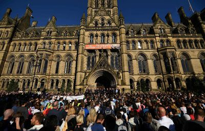 People attend a vigil in Albert Square in Manchester, northwest England on May 23, 2017, in solidarity with those killed an injured in the May 22 terror attack at the Ariana Grande concert at the Manchester Arena. Twenty two people have been killed and dozens injured in Britain's deadliest terror attack in over a decade after a suspected suicide bomber targeted fans leaving a concert of US singer Ariana Grande in Manchester. British police on Tuesday named the suspected attacker behind the Manchester concert bombing as Salman Abedi, but declined to give any further details. LBEN STANSALL/AFP/Getty Images