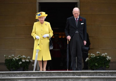 Queen Elizabeth II and Prince Philip, Duke of Edinburgh observe a minute's silence in honour of the victims of the attack at Manchester Arena at the start of a garden party at Buckingham Palace on May 23, 2017 in London, England. (Photo by Dominic Lipinski - WPA Pool / Getty Images)