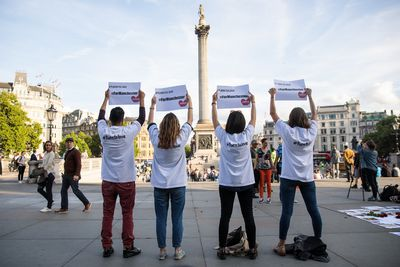 Four people hold up signs which say 'Turn to Love for Manchester' during a vigil for the victims of yesterday's Manchester Arena terror attack in Trafalgar Square on May 23, 2017 in London, England. 22 people, including children were killed and 59 injured in an explosion during a concert at Manchester Arena last night. Greater Manchester Police are treating the incident as a terror attack and say the attacker died in the explosion. (Photo by Jack Taylor/Getty Images)