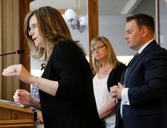 Luke Hendry/The Intelligencer Grace Inn treasurer Michelle Stephens speaks to city council about the soon-to-be-created shelter for homeless people Tuesday in Belleville. With her were secretary Karin Mackay and president and chairman Jodie Jenkins.