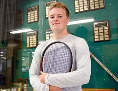 Jack Doris stands in front of the South Grenville District High School trophy case, a place he has already etched his name in as a three-time LGSSAA tennis champion and a two-time EOSSAA champion. (Jonathon Brodie/The Recorder and Times)