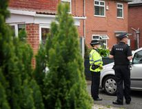 Police officers guard the location of a building where it is believed a number of arrests were made in connection with terrorist Salmon Abedi on May 24, 2017 in Manchester, England. (Photo by Leon Neal/Getty Images)