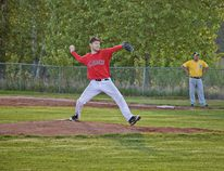 Tom Deming winds up for a pitch during a game against the Grimshaw Huskies in Peace River on Thursday May 18, 2017. The Stamps would win the game 3-2.