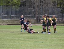 Jolene Michener fights through a tackle attempt during a junior varsity girls rugby game between Gerard Redmond Community Catholic School and Harry Collinge High School on May 18 in Hinton. (John Hopkins-Hill/ Hinton Parklander)