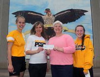 The former Pembroke Ski and Snowboard Club has donated $12,500 to Fellowes High School, which will go towards a $40,000 project to create an outdoor basketball and tennis court. In the photo, graduating students Emily Coulas, left, and Kacie Lafreniere, right, flank Tracy Gilchrist, centre left, Fellowes High School's athletic director, and Hali Clouthier, president of the Pembroke Ski and Snowboard Club.
