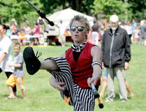 Eric Scott Baker, of the Detroit Circus, plays with fire during the 2015 CK Youth Festival in Tecumseh Park. (File Photo/The Daily News)