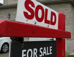 A real estate sale sign is seen here on Wednesday, May 24, 2017 in Listowel, Ont. The Huron Perth Real Association of Realtors says April 2017 was a record-setting month. (Terry Bridge/Beacon Herald/Postmedia Network)