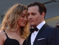 Johnny Depp and Amber Heard arrive for screening of the movie 'Black Mass' presented out of competition at the 72nd Venice International Film Festival on September 4, 2015 at Venice Lido. (TIZIANA FABI/AFP/Getty Images)