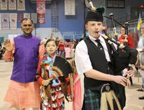 The 15th annual Multicultural Day celebration brought together 28 different countries with about 1,500 attending the event at the Kincardine Davidson Centre on May 16, 2017. The event was open for all to come, sample food and indulge in a wide variety of cultures, with live entertainment to keep them moving. The event has grown significantly over the years and continues in its popularity. L-R: Organizer Chandra Tripathi and First Nation jingle dress dancer Jaylynn Wolfe are piped in by Kincardine Scottish Pipe Band member Nathan Smith. (Ryan Berry/Kincardine News and Lucknow Sentinel)