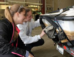 Phylicia Krainz, left, and Mackenzie Oke take a look at algae attached to a boat during Specialist High Skills Major training at D&D Automation Inc. on Thursday, May 25, 2017 in Stratford, Ont. A group of 25 Avon Maitland District School Board students had to come up with a way to reduce or eliminate algae from forming on watercraft. (Terry Bridge/Beacon Herald/Postmedia Network)