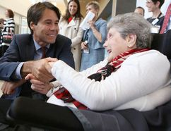 Ontario Minister of Health and Long-Term Care Eric Hoskins talks to Providence Care inpatient Bridgette MacDonald prior to the official opening of the new hospital on Thursday. (Elliot Ferguson/The Whig-Standard)