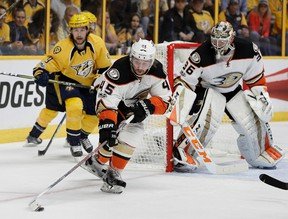 Anaheim Ducks defenceman Sami Vatanen tries to clear the puck in front of goalie John Gibson and Nashville Predators left winger Filip Forsberg during Game 3 of the Western Conference final on May 16, 2017. (AP Photo/Mark Humphrey)
