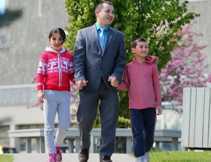 Malik Muradov was photographed walking with his children Meryem, 10, left and Musa, 8 o