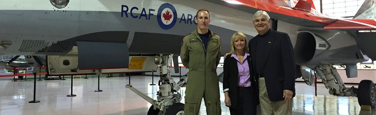 RCAF Capt. Matthew Kutryk  poses Thursday in front of the Canada 150 CF-18 Demo Hornet with Sherry Kerr, president of the Rotary Club of Brantford, and David Rohrer, president and CEO of the Canadian Warplane Heritage Museum. The museum is organizing the Community Charity Airshow on Aug. 30, with help from Rotary. (Michael-Allan Marion/The Expositor)