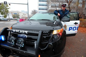 Edmonton Police Service Cst. Scott Anthony with the Ford Police Interceptor Utility (Explorer) in Edmonton, October 10, 2012. The service is six years into the new generation of police vehicles after Ford retired the Crown Victoria. In that time, the SUVs have grown to almost 90 per cent of the EPS's patrol fleet.