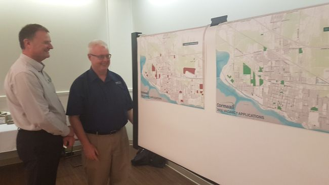 <p>Cornwall city tax collector Stephen Rand, left, and municipal assessor Brad Maloney examine a pair of maps showing the properties that applied for vacancy rebates in 2015 and 2016  on Thursday May 25, 2017 in Cornwall, Ont. </p><p>
