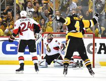 Chris Kunitz scores the Game 7-winning goal for Pittsburgh against the Senators last night. The loss eliminates Ottawa from the playoffs (Getty Images)