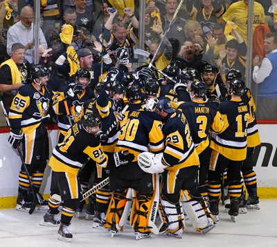 The Pittsburgh Penguins celebrate a game winning goal by Chris Kunitz in the second overtime period of Game 7 of the Eastern Conference final in the NHL Stanley Cup hockey playoffs in Pittsburgh, Friday, May 26, 2017. The Penguins won in double overtime 3-2 to advance to the Stanley Cup Finals. (AP Photo/Gene J. Puskar) ORG XMIT: PAGP103