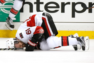 PITTSBURGH, PA - MAY 25:  Mark Stone #61 of the Ottawa Senators lays on the ice after a play againt Carter Rowney #37 of the Pittsburgh Penguins during the third period in Game Seven of the Eastern Conference Final during the 2017 NHL Stanley Cup Playoffs at PPG PAINTS Arena on May 25, 2017 in Pittsburgh, Pennsylvania.  (Photo by Kirk Irwin/Getty Images)