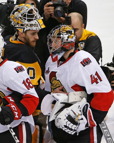 Pittsburgh Penguins goalie Matt Murray, left, and Ottawa Senators goalie Craig Anderson (41) meet in the handshake line following a 3-2 Penguins win in the second overtime period of Game 7 of the Eastern Conference final in the NHL Stanley Cup hockey playoffs in Pittsburgh, Friday, May 26, 2017. The Penguins won in double overtime 3-2 to advance to the Stanley Cup Finals. (AP Photo/Gene J. Puskar) ORG XMIT: PAGP111