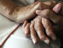 A nurse holds the hands of a person suffering from Alzheimer's disease on September 21, 2009 at Les Fontaines retirement home in Lutterbach , eastern France. (SEBASTIEN BOZON/AFP/Getty Images)