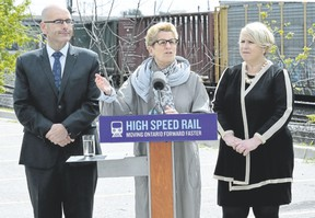 Ontario Premier Kathleen Wynne makes an announcement about high-speed rail with Transportation Minister Steven Del Duca and London North Centre MPP Deb Matthews on May 19. (London Free Press file photo)