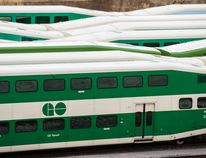 A GO train waits on the track in Toronto. — file photo