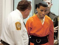 In this Oct. 26, 2004, file photo, Lee Boyd Malvo enters a courtroom in the Spotsylvania, Va., Circuit Court. A federal judge has tossed out two life sentences for D.C. sniper shooter Lee Boyd Malvo and ordered Virginia courts to hold new sentencing hearings. In a ruling issued Friday, U.S. District Judge Raymond Jackson in Norfolk said Malvo is entitled to new sentencing hearings after the U.S. Supreme Court ruled that mandatory life sentences for juveniles are unconstitutional. (Mike Morones/The Free Lance-Star via AP)