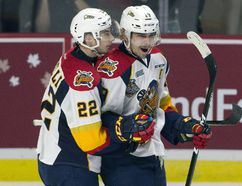 Erie Otters centre Anthony Cirelli (left) congratulates Dylan Strome on his goal against the Saint John Sea Dogs in Windsor, Ont. on Monday, May 22, 2017. (THE CANADIAN PRESS/Adrian Wyld)