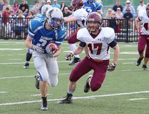 Noah Skuce, left, of the Sudbury Gladiators, attempts to elude Tyler Karpenko, of the Nipissing Wild, during varsity football action at James Jerome Sports Complex in Sudbury, Ont. on Saturday May 27, 2017. John Lappa/Sudbury Star/Postmedia Network
