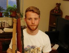 Matthew Prince, 25, recently found a Stevens Savage 87B .22 calibre rifle stashed in an old dresser that someone tossed out with a pile of garbage at the side of a road in the city's west end. (CHRIS DOUCETTE, Toronto Sun)