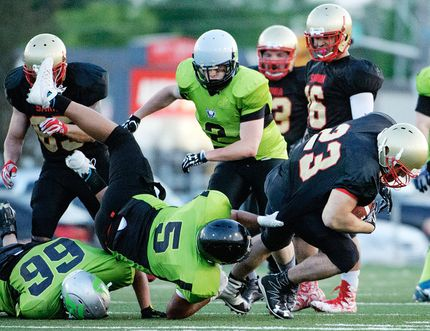 A Sarnia Imperials ball-carrier is tackled during a 45-6 win over the Toronto Raiders in the Northern Football Conferece season opener at Norm Perry Memorial Park in Sarnia on Saturday, May 27, 2017. (DARREN METCALFE/Metcalfe Photography)