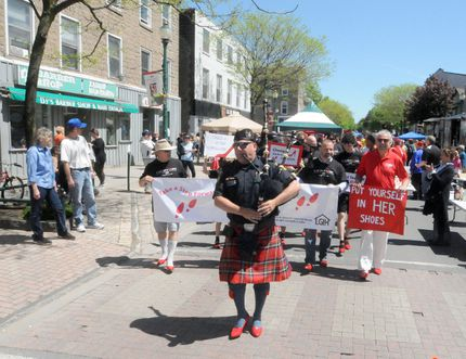 Chief Scott Fraser pipes marchers down King Street.