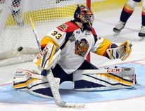 Erie Otters goalie Troy Timpano (33) looks over his shoulder at a goal by Windsor Spitfires centre Aaron Luchuk during the Memorial Cup final in Windsor, Ont., on Sunday, May 28, 2017. (THE CANADIAN PRESS/Adrian Wyld)