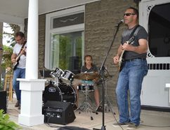Terry Vollum/For The Intelligencer Greg Lott & Friends was one of more than 30 musical acts to make a porch their stage at Saturday's Front Porch Shenanigans. There were 28 different sites scattered throughout the village offering something for every musical taste. Lott's 10-year-old daughter, Katlyn, was solid on drums and a big hit with the crowd.