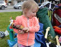 Terry Vollum/For The Intelligencer Marigold Currie was thrilled to find a brand new Pocahontas doll for sale at Stirling Rotary's Giant Yard Sale held last Saturday. As luck would have it Pocahontas just happens to be young Marigold's favourite cartoon character.