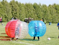 Kids take part in a game of zorb ball during the Soccer Dogs 3 on 3 Tournament in Blenheim on Saturday. (Trevor Terfloth/The Daily News)