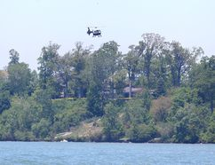 An Ontario Provincial Police helicopter is flown over Lake Erie in Kingsville, Ontario as the search continuesd Monday for the young male involved in a capsized canoe, Sunday.