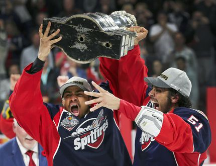 Windsor Spitfires Jeremiah Addison, left, and Jalen Chatfield raise the trophy after defeating the Erie Otters to win the Memorial Cup in Windsor, ON., on Sunday, May 28, 2017 May 28, 2017, at the WFCU Centre in Windsor, ON after defeating the Erie Otters. (DAN JANISSE/The Windsor Star) Memorial Cup