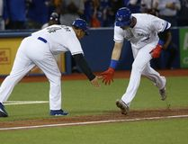 Toronto Blue Jays shortstop Troy Tulowitzki low fives third base coach Luis Rivera after hitting a grand slam in the third inning to put the Jays up 7-1 on the Cincinnati Reds in Toronto on May 29, 2017. (Jack Boland/Toronto Sun/Postmedia Network)